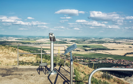 approximation: Sightseeing binoculars and slovak landscape with fields and clouds. Nitra, Slovakia. Tourism theme. Stock Photo