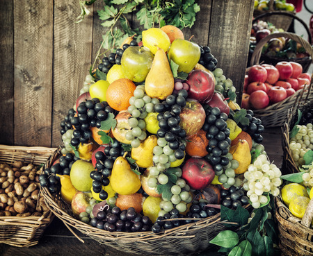 market place: Various fresh fruits in the wicker baskets. Healthy food. Market place. Vitamin bomb. Stock Photo