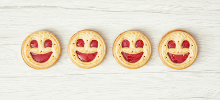 biscuits: Four round biscuits smiling faces. Humorous food.