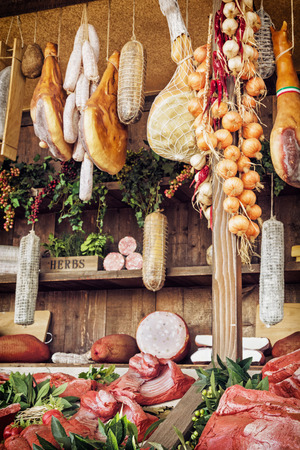 Various meat products at the food market. Food theme. Vertical composition.
