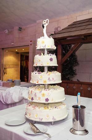 symbolic: Big wedding cake on the table. Symbolic food. Stock Photo