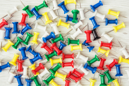 push in pins: Background of coloured thumbtacks - office push pins. Office supplies.