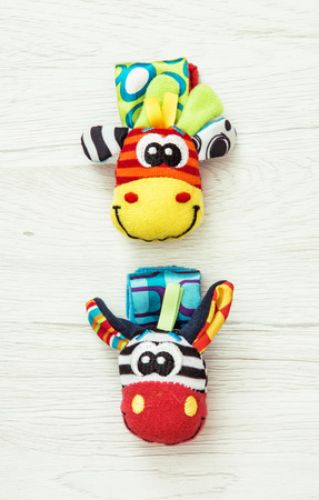 glove puppet: Two colorful wrist pals on the wooden background. Funny toys. Vibrant colors. Stock Photo