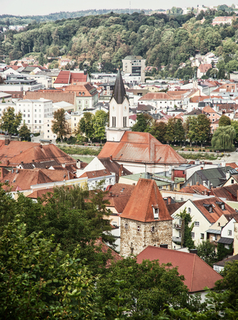 church tower: Roofs in Passau city with church tower. Architectural scene in Germany. Vertical composition. Stock Photo