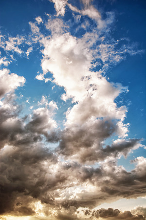 vertical composition: Dramatic stormy sky. Natural scene. Dark and light tones. Vertical composition. Stock Photo