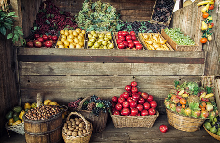 Various fresh fruits in the wicker baskets and crates. Fruit market. Healthy food. Vitamin bomb.