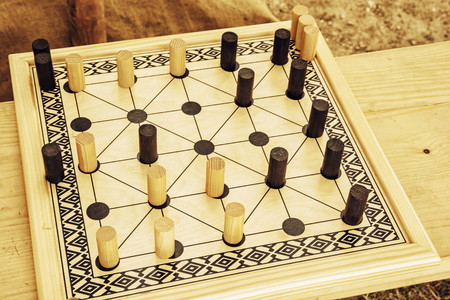 strategical: Wooden brain board game. Leisure game. Alquerque board game. Stock Photo