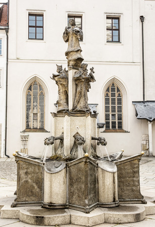 compostion: Sculpture on the courtyard of famous Saint Stephens cathedral in Passau, Germany. Religious architecture. Vertical compostion.