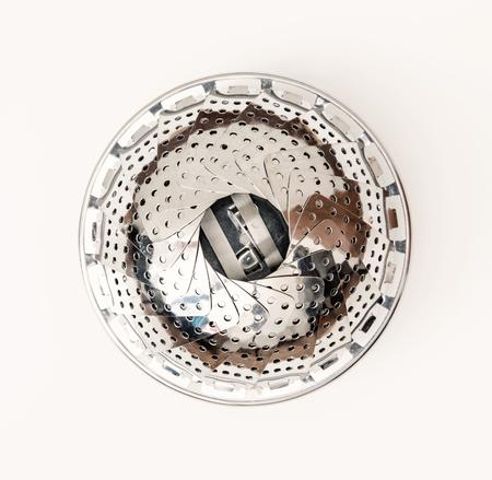 kitchen equipment: Metallic circle strainer on the wooden background. Kitchen equipment. Circle colander. Kitchen tool. Close up photo. Stock Photo