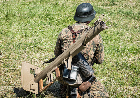 german soldier: NITRA, SLOVAK REPUBLIC - MAY 21: Reconstruction of the Second World War operations Between Red and German army, german soldier with armor-fist with looks around the battlefield on May 21, 2016 in Nitra, Slovak Republic.