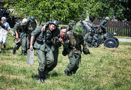 strife: NITRA, SLOVAK REPUBLIC - MAY 21: Reconstruction of the Second World War operations Between Red and German army, german rescue of wounded soldiers on the battlefield on May 21, 2016 in Nitra, Slovak Republic.