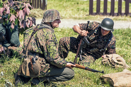 battleground: NITRA, SLOVAK REPUBLIC - MAY 21: Reconstruction of the Second World War operations Between Red and German army, german soldiers in defensive position on May 21, 2016 in Nitra, Slovak Republic.