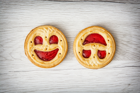 Two round biscuits smiling faces. Humorous sweet food. Tasty cookies. Good mood. Jam biscuits.