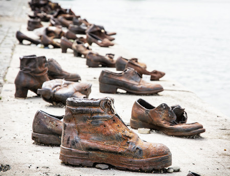 reverence: Shoes on the Danube bank is a memorial in Budapest, Hungary. Place of reverence. Cultural heritage. Symbolic object. Shoes monument.