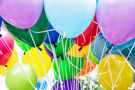 leisure activity: Balloons party. Colorful balloons background. Leisure activity. Funny symbolic objects. Vibrant colors.