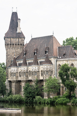 vertical composition: Beautiful Vajdahunyad castle in Budapest, Hungary. Cultural heritage. Travel destination. Vertical composition. Famous place. Tourism theme. Architectural theme.