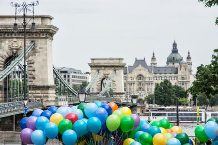 famous place: Famous Chain bridge, Saint Stephens basilica and colorful balloons in Budapest, Hungary. Cultural heritage. Entertainment event. Travel destination. Famous place. Tourism theme. Vibrant colors. Architectural theme.
