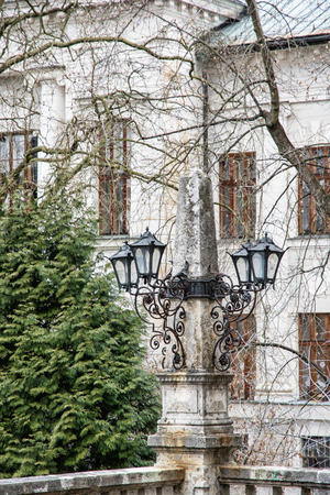 vertical composition: Old decorative lamps and facade of historic building in Banska Stiavnica, Slovakia. Artistic objects. Architectural element. Vertical composition.
