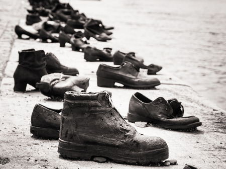 reverence: Shoes on the Danube bank is a memorial in Budapest, Hungary. Place of reverence. Black and white photo. Cultural heritage. Symbolic object. Shoes monument. Stock Photo