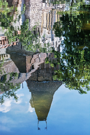 famous place: Beautiful Vajdahunyad castle is reflected in the water of the lake, Budapest, Hungary. Cultural heritage. Travel destination. Vertical composition. Famous place. Tourism theme. Architectural theme.
