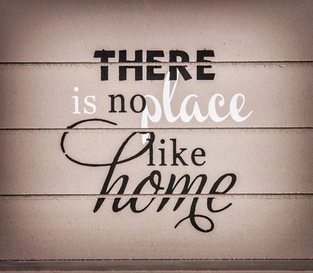 symbolic: There is no place like home. Title on the wooden background. Symbolic inscription. Stock Photo