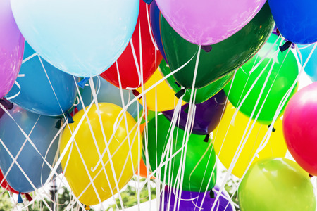 vibrant colors fun: Balloons party. Funny symbolic objects. Colorful balloons background. Leisure activity. Vibrant colors.