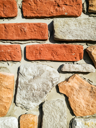 vertical composition: Detail of red brick wall. Architectural element. Vertical composition.