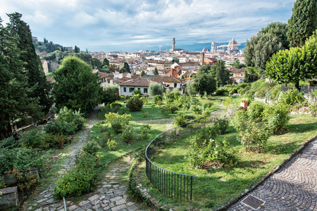 giardino: View from Giardino delle Rose to the city of Florence. Tuscany, Italy. Travelling scene. Beautiful place. Greenery and town. Cradle of the renaissance. Cultural heritage.
