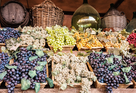 market place: Different varieties of grapes in the wicker baskets. Market place. Healthy food.