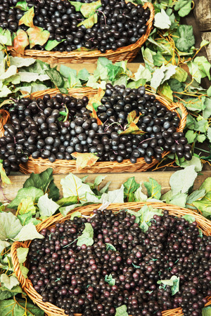 market place: Different varieties of grapes in the wicker baskets. Market place. Healthy food. Vertical composition.