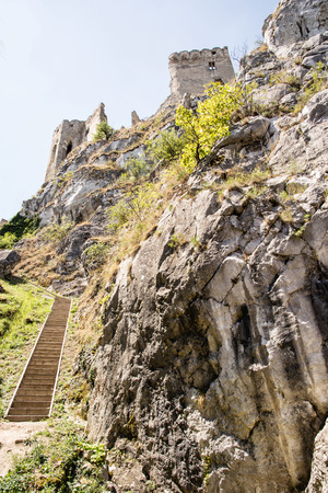 central europe: Beckov castle ruins, Slovak republic, central Europe. Vertical composition. Travel destination. Beautiful place. Cultural heritage. Big rock.