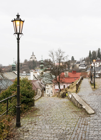 street lights: Banska Stiavnica in Slovak republic, historical center and New castle. Cultural heritage. Vertical composition. Architectural scene. Street lights. Stock Photo