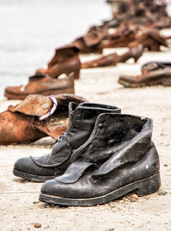 vertical composition: Shoes monument on the Danube bank is a memorial in Budapest, Hungary. Place of reverence. Cultural heritage. Symbolic object. Vertical composition.