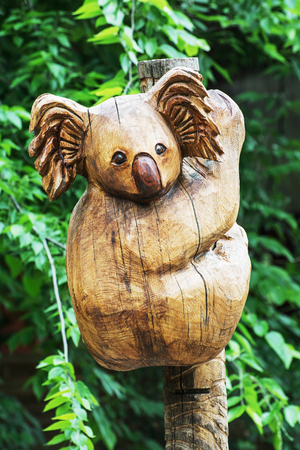 zoology: Wooden statue of cute koala. Artistic object. Vertical composition. Zoology theme. Stock Photo