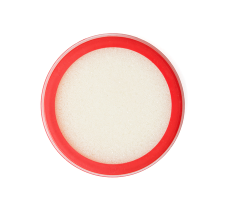 simplification: Round plastic sponge case for dipping fingers isolated on the white background. Office supplies. Stock Photo