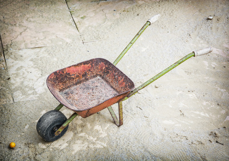 wheelbarrow: Old wheelbarrow on site. Hand cart.