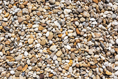 smooth stones: Background of yellow smooth stones. Natural scene. Beautiful pebbles. Geology theme.