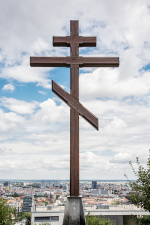 memorial cross: Big christian cross in Slavin, memorial monument and military cemetery in Bratislava, the capital of Slovak republic. Religious object. Cultural heritage. Architectural theme. Vertical composition.