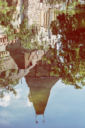 famous place: Beautiful Vajdahunyad castle is reflected in the water of the lake, Budapest, Hungary. Cultural heritage. Travel destination. Vertical composition. Famous place. Retro photo filter. Architectural theme. Editorial