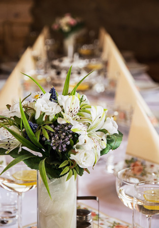 vermouth: Beautiful bouquet, glasses of vermouth with lemon and decorative napkins on the table. Birthday party. Refreshments theme.