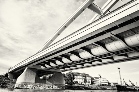 slovak republic: Modern Apollo bridge in Bratislava, Slovak republic. Architectural theme. Danube river. Black and white photo. Ship transportation. Infrastructure theme.