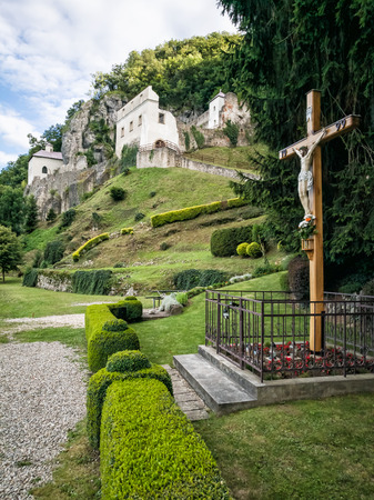 place of worship: Monastery Skalka near Trencin, Slovak republic. Place of worship. Architectural theme. Religious symbol. Crucifixion of Jesus Christ. Cultural heritage. Stock Photo