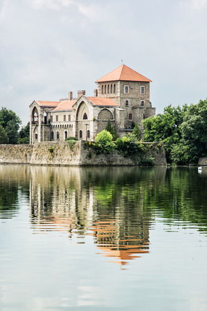 Beautiful castle in Tata, Hungary. Travel destination. Architectural theme. Beautiful place. Fortress is reflected in the lake. Vertical composition. Redakční