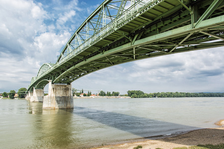 joins: Maria Valeria bridge joins Esztergom in Hungary and Sturovo in Slovak republic across the Danube river. Architectural scene. Transportation theme. Stock Photo