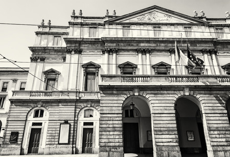 opera house: La Scala is an opera house in Milan, Italy. Cultural heritage. Travel destination. Black and white photo. Architectural scene.