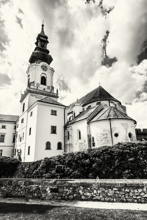 vertical composition: Ancient castle in Nitra, Slovak republic. Cultural heritage. Black and white photo. Architectural theme. Place for worship. Vertical composition.