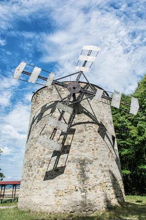 slovak republic: Old tower windmill in Holic, Slovak republic. Architectural theme. Vertical composition. Cultural heritage. Beautiful object. Travel destination.