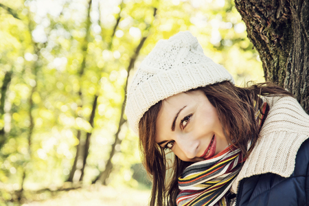 color in: Young youful caucasian woman posing in autumn park. Seasonal fashion. Female portrait. Vibrant colors.