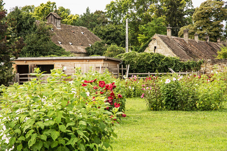 old houses: Old houses with garden flowers in village, Hungary. Beautiful place. Tourist destination. Gardening theme.