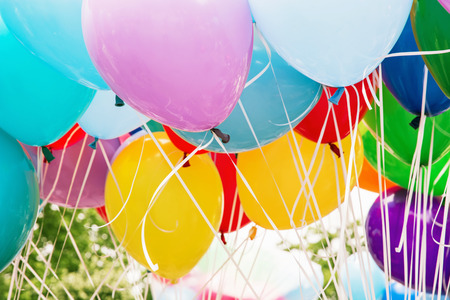 leisure activity: Balloons party. Funny symbolic objects. Colorful balloons background. Retro objects. Leisure activity. Vibrant colors. Stock Photo